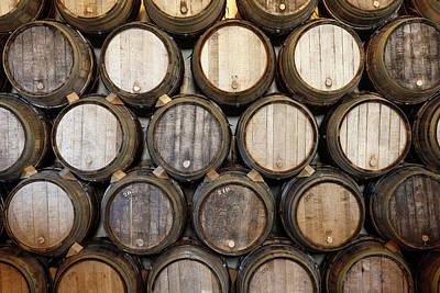 Large Oak Tree Photograph - Stacked Oak Barrels In A Winery by Marc Volk