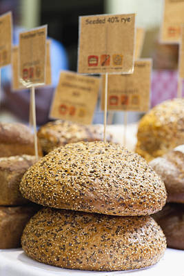 Stacks Of Fresh Bread For Sale Art Print by Hybrid Images