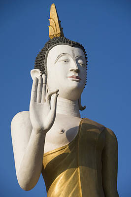 Diety Photograph - Statue Of Buddha At Wat That Luang Tai by Axiom Photographic
