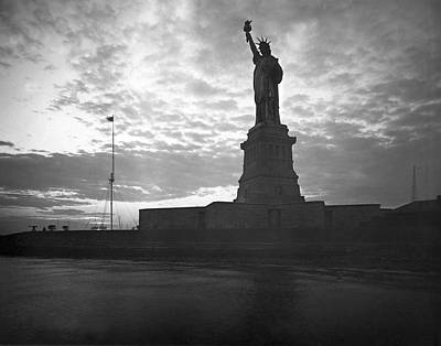 Statue Of Liberty At Sunset Art Print by Underwood Archives
