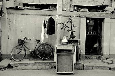 Photograph - Still Life With Bicycles And Laundry by Dean Harte