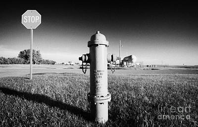 Stop Sign Against Blue Sky And Red Darling Valve Fire Hydrant In Rural Michigan North Dakota Usa Print by Joe Fox