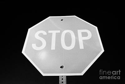 Stop Sign Against Blue Sky In North Dakota Usa United States Of America Print by Joe Fox