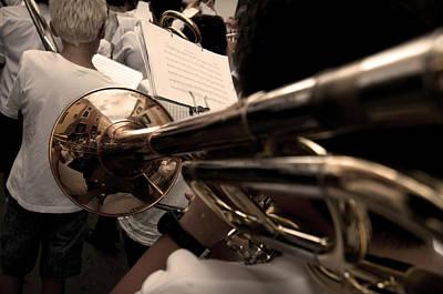 Photograph - street band - A vintage trombone mirroring buildings arround in calan porter - menorca by Pedro Cardona
