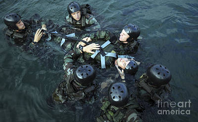 Students Secure A Simulated Casualty Art Print by Stocktrek Images