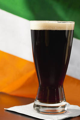 Photograph - Studio Shot Of Glass Of Stout Beer With Irish Flag by Vstock LLC