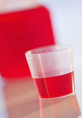 Cough Medicine Photograph - Studio Shot Of Red Medicine by Daniel Grill