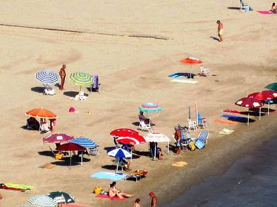 Photograph - Sun Bathers And Beach Umbrellas In Peniscola Spain by John Shiron