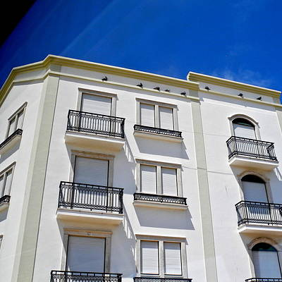Photograph - Sun Drenched Building In Nazare by Kirsten Giving