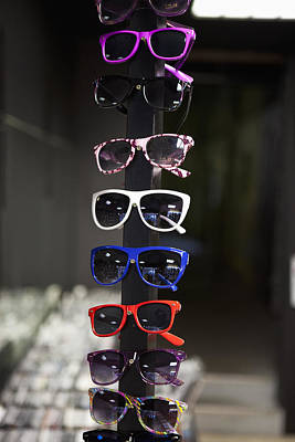 Ordering Photograph - Sunglasses On Display In A Store by Halfdark