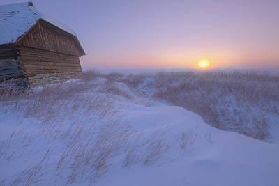 Sunrise On Abandoned, Snow-covered Art Print by Dan Jurak