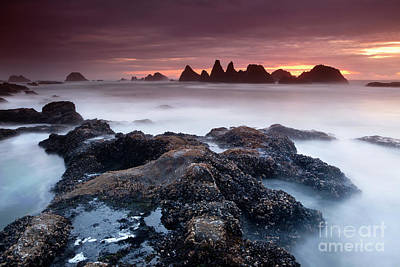 Turbulent Skies Photograph - Sunset At Seal Rock by Keith Kapple
