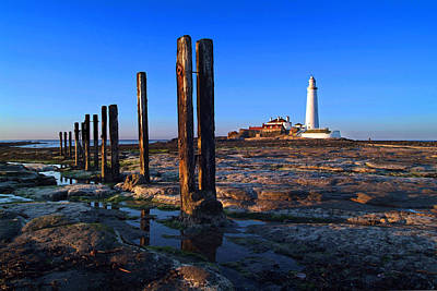 Sunset At St. Mary's Lighthouse Art Print by Michael Oakes