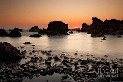Turbulent Skies Photograph - Sunset On A Rock by Keith Kapple