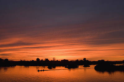 Boats In Reflecting Water Photograph - Sunset Over River by Axiom Photographic