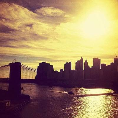 Sunset Over The New York City Skyline And The Brooklyn Bridge Art Print