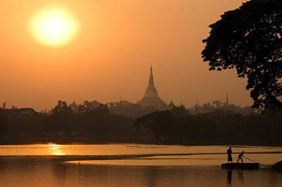 Sunset Over The Shwedagon Pagoda Art Print by Austin Bush