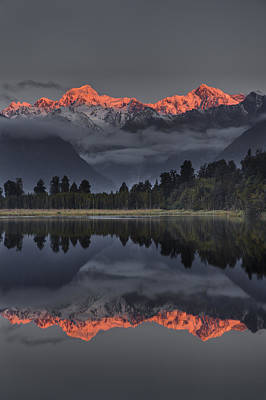 Sunset Reflection Of Lake Matheson Art Print by Colin Monteath