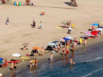 Photograph - Swimming And Beach Umbrellas At Peniscola Beach Spain by John Shiron