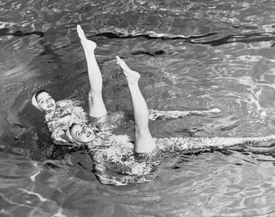Human Limb Photograph - Synchronised Swimmers by Fpg