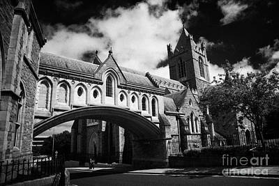 Holy Trinity Cathedral Photograph - synod house stone bridge and Christ Church cathedral cathedral of the holy trinity church of ireland by Joe Fox