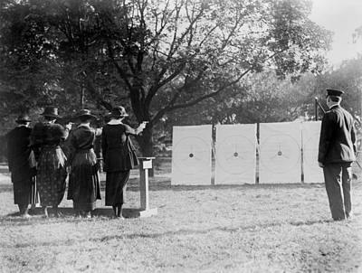 1920s Candid Photograph - Target Shooting, Four Women Shooting by Everett