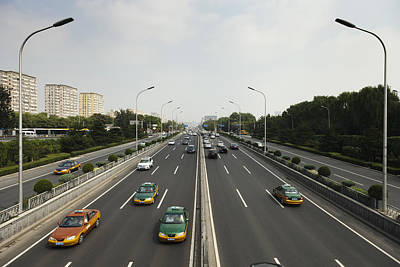Traffic Congestion Photograph - Taxis And Other Cars Drive The Second by Roberto Westbrook