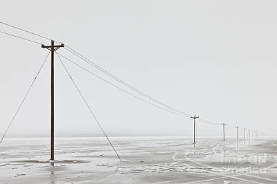 Telephone Poles In Bleak Winter Landscape Art Print by Dave & Les Jacobs