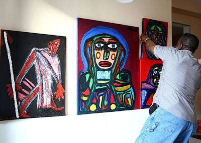 Darren Mixed Media - The Artist Darrell Black In His Studio Hanging Paintings by Darrell Black