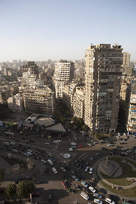 Ancient Apartments Photograph - The Busy Traffic Of Downtown Cairo by Taylor S. Kennedy