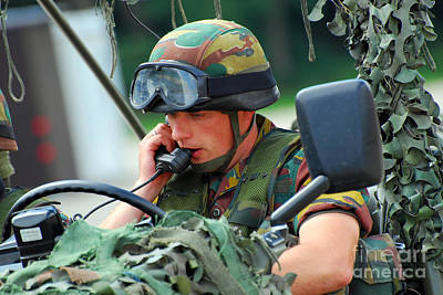 Talking On The Phone Photograph - The Driver Of A Mortar Section by Luc De Jaeger