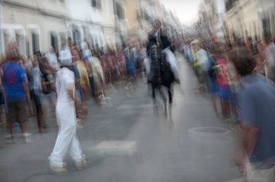 Photograph - The Man In The Middle Of The Race by Pedro Cardona