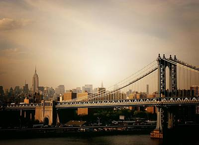 The New York City Skyline And Manhattan Bridge At Sunset Art Print by Vivienne Gucwa