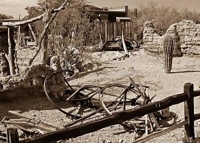 Wagon Wheel Hub Wall Art - Photograph - The Old Bygone West by Douglas Barnett