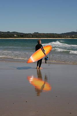 The Orange Surfboard Art Print by Jan Lawnikanis