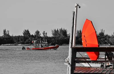Fort Pierce Inlet Photograph - The Red Umbrella And The Coast Guard Boat by Lynda Dawson-Youngclaus