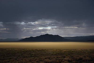 The Setting Sun Permeates Rain Clouds Print by James P. Blair