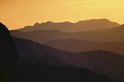 The Silhouetted Mountains Range In Hues Art Print by Michael S. Quinton