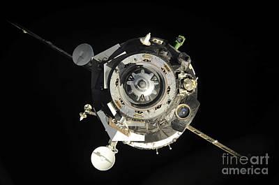 The Soyuz Tma-17 Spacecraft Departs Art Print by Stocktrek Images