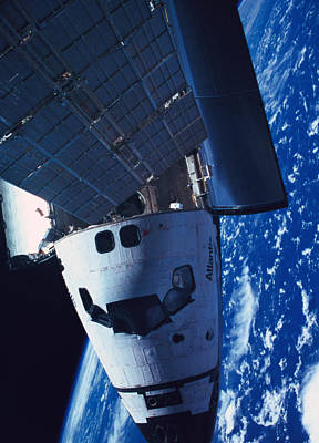 Blue Planet Photograph - The Space Shuttle Docked With A Space Station by Stockbyte