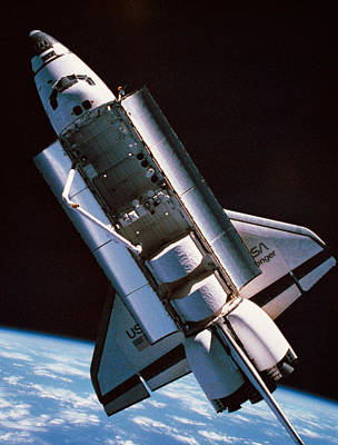 The Space Shuttle With Cargo Bay Open Orbiting Above Earth Art Print by Stockbyte