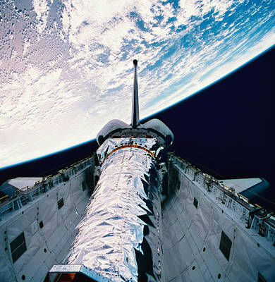 The Space Shuttle With Its Open Cargo Bay Orbiting Above The Earth Art Print by Stockbyte