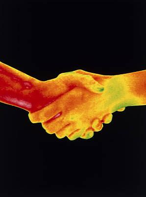 Thermogram Of A Handshake Art Print by Dr. Arthur Tucker