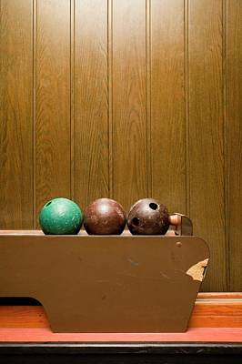 Wood Grain Photograph - Three Bowling Balls In Bowling Alley by Benne Ochs