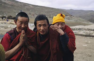 Three Buddhist Lamas In Gansu Province Art Print by David Edwards