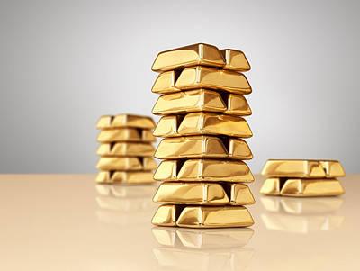 Three Different Sized Stacks Of Gold Ingots Print by Anthony Bradshaw