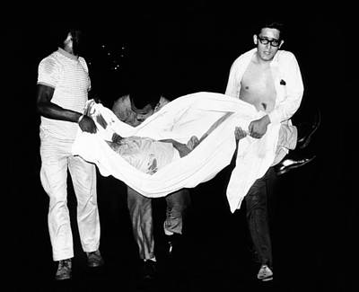 Three Men Carry Body Of A Youth Who Art Print by Everett