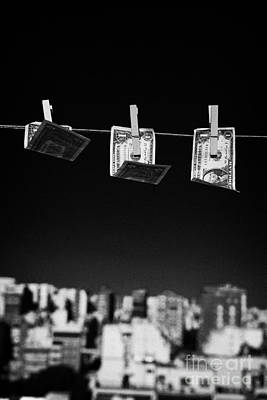 Three One Dollar Bills Blowing In The Wind Hanging On A Washing Line With Blue Sky Over A City Art Print