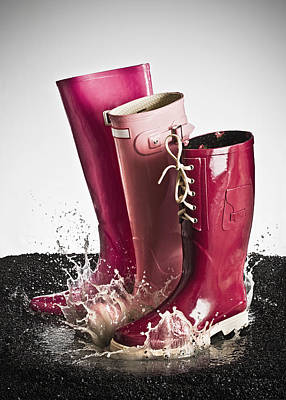 Y120817 Photograph - Three Pink Rubber Boots Splashing In A Puddle by Larry Washburn