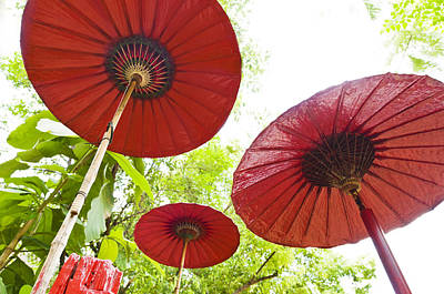 Photograph - Three Red Umbrella In A Outdoor Setting by Ulrich Schade